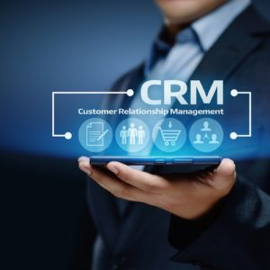 Man holding digital rendering of CRM